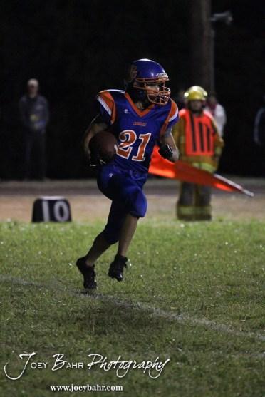 Otis-Bison Cougar Brad Lightfoot (#21) returns a kick during the Sylvan-Lucas vs Otis-Bison High School football game with Otis-Bison winning 32 to 30 at Otis-Bison High School Field in Otis, Kansas on October 31, 2013. (Photo: Joey Bahr, www.joeybahr.com)