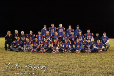 The Otis-Bison Cougars take a team picture following the Sylvan-Lucas vs Otis-Bison High School football game with Otis-Bison winning 32 to 30 at Otis-Bison High School Field in Otis, Kansas on October 31, 2013. (Photo: Joey Bahr, www.joeybahr.com)