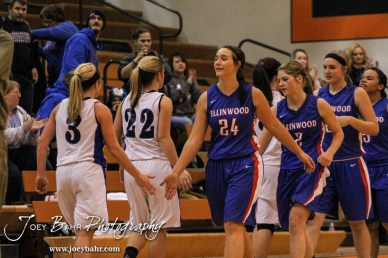 Members of the St. John Lady Tigers and Ellinwood Lady Eagles shake hands following the Opening Round of the Seventh Annual Keady Basketball Classic matchup between the Ellinwood Lady Eagles and the St. John Lady Tigers with Ellinwood winning 40 to 38 in overtime at Larned Middle School in Larned, Kansas on December 9, 2013. (Photo: Joey Bahr, www.joeybahr.com)