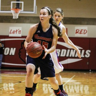 Minneapolis Lady Lion Kynedi Allison (#15) drives towards the basket during the 2014 Hoisington Cardinal Winter Jam Girls Championship basketball game with the Ellinwood Lady Eagles versus the Minneapolis Lady Lions with Ellinwood winning 57 to 48 at the Hoisington Activity Center in Hoisington, Kansas on January 25, 2014. (Photo: Joey Bahr, www.joeybahr.com)