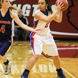 Ellinwood Lady Eagle Twany Arndt (#5) looks for a teammate to pass the ball to during the 2014 Hoisington Cardinal Winter Jam Girls Championship basketball game with the Ellinwood Lady Eagles versus the Minneapolis Lady Lions with Ellinwood winning 57 to 48 at the Hoisington Activity Center in Hoisington, Kansas on January 25, 2014. (Photo: Joey Bahr, www.joeybahr.com)