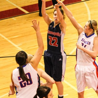 Minneapolis Lady Lion Lindsay Shupe (#22) shoots a shot over the Ellinwood Lady Eagle defense during the 2014 Hoisington Cardinal Winter Jam Girls Championship basketball game with the Ellinwood Lady Eagles versus the Minneapolis Lady Lions with Ellinwood winning 57 to 48 at the Hoisington Activity Center in Hoisington, Kansas on January 25, 2014. (Photo: Joey Bahr, www.joeybahr.com)