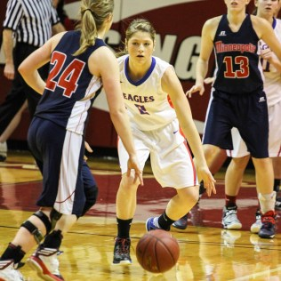 Ellinwood Lady Eagle Sophie Hayes (#2) watches Minneapolis Lady Lion Mara Pounds (#24) dribble the ball down the court during the 2014 Hoisington Cardinal Winter Jam Girls Championship basketball game with the Ellinwood Lady Eagles versus the Minneapolis Lady Lions with Ellinwood winning 57 to 48 at the Hoisington Activity Center in Hoisington, Kansas on January 25, 2014. (Photo: Joey Bahr, www.joeybahr.com)