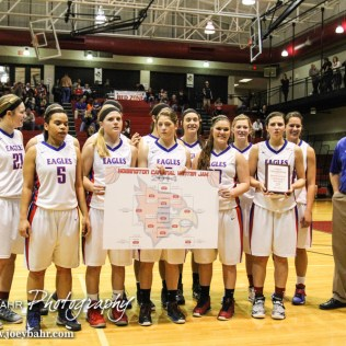 The Ellinwood Lady Eagles show off their winning bracket during the 2014 Hoisington Cardinal Winter Jam Girls Championship basketball game with the Ellinwood Lady Eagles versus the Minneapolis Lady Lions with Ellinwood winning 57 to 48 at the Hoisington Activity Center in Hoisington, Kansas on January 25, 2014. (Photo: Joey Bahr, www.joeybahr.com)
