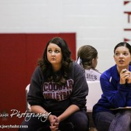 Otis-Bison Lady Cougar Head Coach Sarah Gregory and Assistant Coach Danielle Espinosa watch the ball being served during the Otis-Bison versus LaCrosse Pool Play match at the Central Prairie League Tourament with Otis-Bison winning 25-22, 20-25, and 25-19 at Hoisington Middle School in Hoisington, Kansas on October 19, 2013. (Photo: Joey Bahr, www.joeybahr.com)