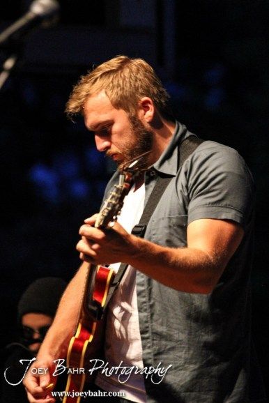 Logan Mize tunes his guitar durning the Ellinwood After Harvest Festival at City Park in Ellinwood, Kansas on July 17, 2014. (Photo: Joey Bahr, www.joeybahr.com)