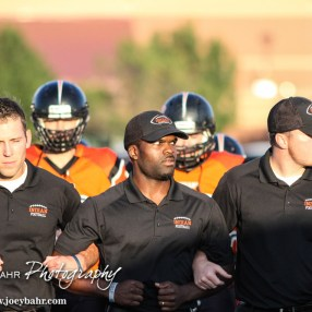 Larned Indian Head Coach AB Stokes leads his team to the field prior to the Kingman Eagles versus Larned Indians High School Football Game with Kingman winning 3 to 0 at Earl Roberts Field at Larned High School near Larned, Kansas on September 19, 2014. (Photo: Joey Bahr, www.joeybahr.com)