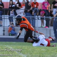 Kingman Eagle Devon Braden (#1) tries to tackle Larned Indian Evan Skelton (#1) during the Kingman Eagles versus Larned Indians High School Football Game with Kingman winning 3 to 0 at Earl Roberts Field at Larned High School near Larned, Kansas on September 19, 2014. (Photo: Joey Bahr, www.joeybahr.com)