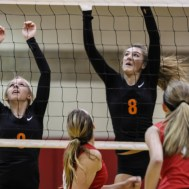 Larned Lady Indians Kaitlyn Nolde (#9) and Jessica Gobin (#8) try to set a wall during the Kingman Lady Eagles versus Larned Lady Indians volleyball match with Kingman winning 25-21, 24-26, 25-15 at Hoisington Activity Center in Hoisington, Kansas on September 9, 2014. (Photo: Joey Bahr, www.joeybahr.com)