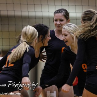 The Larned Lady Indians celebrate winning a point during the Kingman Lady Eagles versus Larned Lady Indians volleyball match with Kingman winning 25-21, 24-26, 25-15 at Hoisington Activity Center in Hoisington, Kansas on September 9, 2014. (Photo: Joey Bahr, www.joeybahr.com)