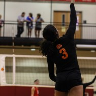 Larned Lady Indian Maci Perez (#3) serves the ball during the Kingman Lady Eagles versus Larned Lady Indians volleyball match with Kingman winning 25-21, 24-26, 25-15 at Hoisington Activity Center in Hoisington, Kansas on September 9, 2014. (Photo: Joey Bahr, www.joeybahr.com)