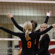 Larned Lady Indian Kaitlyn Finger (#12) looks back as the ball is being served during the Kingman Lady Eagles versus Larned Lady Indians volleyball match with Kingman winning 25-21, 24-26, 25-15 at Hoisington Activity Center in Hoisington, Kansas on September 9, 2014. (Photo: Joey Bahr, www.joeybahr.com)
