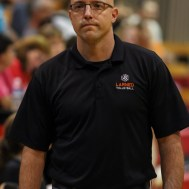Larned Lady Indian Head Coach Paul Deveaux reacts to loosing a point during the Kingman Lady Eagles versus Larned Lady Indians volleyball match with Kingman winning 25-21, 24-26, 25-15 at Hoisington Activity Center in Hoisington, Kansas on September 9, 2014. (Photo: Joey Bahr, www.joeybahr.com)