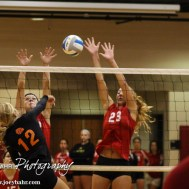 Larned Lady Indian Kaitlyn Finger (#12) goes for a kill during the Kingman Lady Eagles versus Larned Lady Indians volleyball match with Kingman winning 25-21, 24-26, 25-15 at Hoisington Activity Center in Hoisington, Kansas on September 9, 2014. (Photo: Joey Bahr, www.joeybahr.com)
