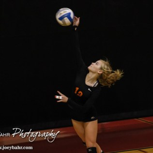Larned Lady Indian Kaitlyn Finger (#12) serves the ball during the Kingman Lady Eagles versus Larned Lady Indians volleyball match with Kingman winning 25-21, 24-26, 25-15 at Hoisington Activity Center in Hoisington, Kansas on September 9, 2014. (Photo: Joey Bahr, www.joeybahr.com)