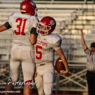 McPherson Bullpup Kyler Kinnamon (#5) celebrates scoring a touchdown during the McPherson Bullpups versus Salina South Cougars High School Football gamme with Salina South winning 61 to 32 at Salina Stadium in Salina, Kansas on September 4, 2014. (Photo: Joey Bahr, www.joeybahr.com)