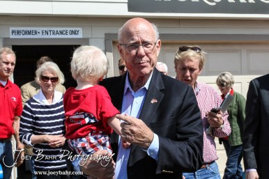 United States Senator Pat Roberts points to his Grandson while talking to the assembled press after the WIBW 2014 Kansas State Fair Senate debate between United States Senator Pat Roberts and Greg Orman at Bretz-Young Injury Lawyers Arena on the Kansas State Fairgrounds in Hutchinson, Kansas on September 6, 2014. (Photo: Joey Bahr, www.joeybahr.com)