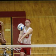 Kinsley Lady Coyote Paige Herrmann (#10) digs the ball during the 2014 Central Prairie League Volleyball Tournament at Hoisington Activity Center in Hoisington, Kansas on October 18, 2014. (Photo: Joey Bahr, www.joeybahr.com)