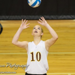 Victoria Lady Knight Sam Leiker (#10) sets the ball during the 2014 Central Prairie League Volleyball Tournament at Hoisington Activity Center in Hoisington, Kansas on October 18, 2014. (Photo: Joey Bahr, www.joeybahr.com)