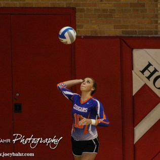Otis-Bison Lady Cougar Taylor Regan (#10) serves the ball during the 2014 Central Prairie League Volleyball Tournament at Hoisington Activity Center in Hoisington, Kansas on October 18, 2014. (Photo: Joey Bahr, www.joeybahr.com)