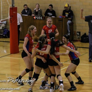 The Ellinwood Lady Eagles celebrate scoring a point during the 2014 Central Prairie League Volleyball Tournament at Hoisington Activity Center in Hoisington, Kansas on October 18, 2014. (Photo: Joey Bahr, www.joeybahr.com)