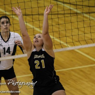 LaCrosse Lady Leopard Marissa Wagner (#21) sets the ball during the 2014 Central Prairie League Volleyball Tournament at Hoisington Activity Center in Hoisington, Kansas on October 18, 2014. (Photo: Joey Bahr, www.joeybahr.com)