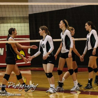 The LaCrosse Lady Leopards and Central Plains Lady Oilers shake hands following their match during the 2014 Central Prairie League Volleyball Tournament at Hoisington Activity Center in Hoisington, Kansas on October 18, 2014. (Photo: Joey Bahr, www.joeybahr.com)