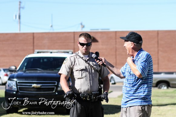 Eagle Radio's Steve Webster interviews Great Bend Police Department Officer Adam Hale during the KVGB AM 1590 City Edition Show with the Great Bend Police Department at Eagle Radio Broadcast Center in Great Bend, Kansas on October 15, 2014. (Photo: Joey Bahr, www.joeybahr.com)