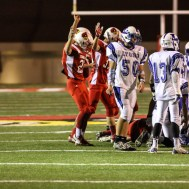 The Hoisington Cardinals signal that they recovered a fumble during the Hoisington Cardinals versus Lyons Lions High School Football game with Hoisington winning 54 to 13 at Elton Brown Field at Hoisington High School in Hoisington, Kansas on October 30, 2014. (Photo: Joey Bahr, www.joeybahr.com)