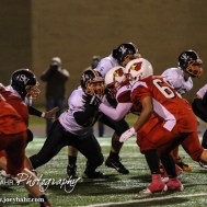 Smoky Valley Viking Caden Byers (#50) blocks a Hoisington Cardinal during the Hoisington High School versus Smoky Valley football game with Hoisington winning 33 to 12 at Eldon Brown Field in Hoisington, Kansas on October 10, 2014. (Photo: Joey Bahr, www.joeybahr.com)