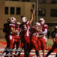 Hoisington Cardinal KC Stephens (#43) celebrates scoring a touchdown during the Hoisington High School versus Smoky Valley football game with Hoisington winning 33 to 12 at Eldon Brown Field in Hoisington, Kansas on October 10, 2014. (Photo: Joey Bahr, www.joeybahr.com)