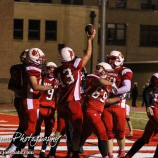 Hoisington Cardinal KC Stephens (#43) celebrates scoring a touchdown during the Hoisington High School versus Smoky Valley football game with Hoisington winning 33 to 12 at Eldon Brown Field in Hoisington, Kansas on October 10, 2014. (Photo: Joey Bahr, www.joeybahr.com)