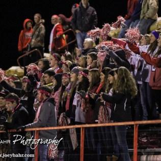 Hoisington Cardinal fans cheer on their team during the Hoisington High School versus Smoky Valley football game with Hoisington winning 33 to 12 at Eldon Brown Field in Hoisington, Kansas on October 10, 2014. (Photo: Joey Bahr, www.joeybahr.com)