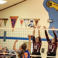 Plainville Lady Cardinals Maeson Dewey (#10) and Brianna Casey (#12) set a wall during the Otis-Bison/LaCrosse Volleyball Tournament Pool Play at Otis-Bison High School in Otis, Kansas on September 13, 2014. (Photo: Joey Bahr, www.joeybahr.com)