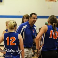 Otis-Bison Lady Cougar Head Coach Erin Patrick talks to his players during a time out during the Otis-Bison/LaCrosse Volleyball Tournament Pool Play at Otis-Bison High School in Otis, Kansas on September 13, 2014. (Photo: Joey Bahr, www.joeybahr.com)