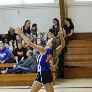 Otis-Bison Lady Cougar Demi Bartonek (#19) serves the ball during the Otis-Bison/LaCrosse Volleyball Tournament Pool Play at Otis-Bison High School in Otis, Kansas on September 13, 2014. (Photo: Joey Bahr, www.joeybahr.com)