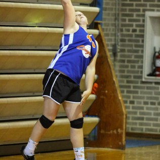 Otis-Bison Lady Cougar Jenna Hlavaty (#45) serves the ball during the Otis-Bison Lady Cougar Junior Varsity Volleyball Game with the Ellinwood Lady Eagles at Ellinwood High School in Ellinwood, Kansas on October 14, 2014. (Photo: Joey Bahr, www.joeybahr.com)