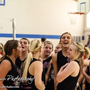 The Otis-Bison Lady Cougars huddle up before the Otis-Bison High School versus Macksville volleyball game at Otis-Bison High School in Otis, Kansas on October 7, 2014. (Photo: Joey Bahr, www.joeybahr.com)