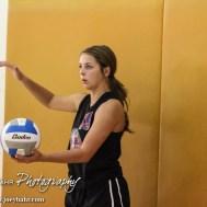 Otis-Bison Lady Cougar Demi Bartonek (#19) serves the ball during the Otis-Bison High School versus Macksville volleyball game at Otis-Bison High School in Otis, Kansas on October 7, 2014. (Photo: Joey Bahr, www.joeybahr.com)