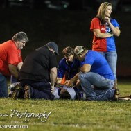 Paramedics tend to Spearville Lancer Waylon Strecker (#10) after he was hurt on a kick off during the Spearville at Hodgeman County High School Football Game with Spearville winning 50 to 28 at Sayler Field in Jetmore, Kansas on October 24, 2014. (Photo: Joey Bahr, www.joeybahr.com)