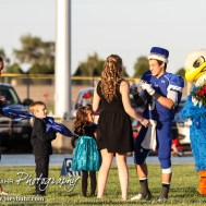 Ness City Eagle Pedro Flores (#3) crowns the Homecoming Queen before the Spearville versus Ness City High School 8-Man Football Game with Spearville winning 50 to 38 at Ness City High School in Ness City, Kansas on October 3, 2014. (Photo: Joey Bahr, www.joeybahr.com)