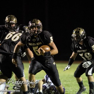 LaCrosse Leopard Jack Garcia (#5) runs up the middle during the KSHSAA Class 2-1A Regional Football game with Meade at LaCrosse with LaCrosse winning 34 to 0 at Bill Schoendaller Athletic Field in LaCrosse, Kansas on November 7, 2014. (Photo: Joey Bahr, www.joeybahr.com)