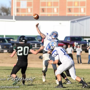 Spearville Lancer Nathan Stein (#8) throws a pass during the KSHSAA Eight Man Division I Regional Football game between Spearville and Central Plains with Central Plains winning 42 to 40 at Central Plains High School in Claflin, Kansas on November 8, 2014. (Photo: Joey Bahr, www.joeybahr.com)