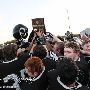 The Central Plains Oilers hold up the Regional Champions Trophy after the KSHSAA Eight Man Division I Regional Football game between Spearville and Central Plains with Central Plains winning 42 to 40 at Central Plains High School in Claflin, Kansas on November 8, 2014. (Photo: Joey Bahr, www.joeybahr.com)