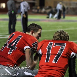 Great Bend Panther Wyatt Bryant (#44) and Ty Yager (#17) take a knee as a teammate is looked at by trainers during the Salina South versus Great Bend High School Football Game with Salina South winning 35 to 21 at Memorial Stadium in Great Bend, Kansas on October 31, 2014. (Photo: Joey Bahr, www.joeybahr.com)