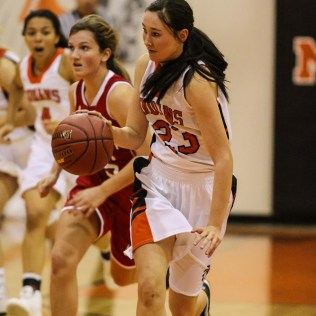 Larned Lady Indian ShyAnn Robison (#23) drives down the court during Seventh Annual Keady Basketball Classic First Round game between the Kinsley Lady Coyotes and the Larned Lady Indians with Kinsley winning 47 to 31 at Larned Middle School in Larned, Kansas on December 8, 2014. (Photo: Joey Bahr, www.joeybahr.com)