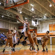 St. John Tiger Dean Wade (#32) goes for a layup during the Seventh Annual Keady Basketball Classic First Round game between the St. John Tigers and the Kiowa County Mavericks with St. John winning 74 to 30 at Larned Middle School in Larned, Kansas on December 9, 2014. (Photo: Joey Bahr, www.joeybahr.com)