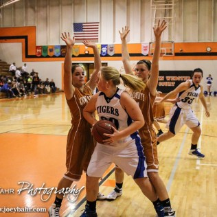 St. John Lady Tiger Tara Nelson (#20) looks for a teammate to pass the ball to during the Seventh Annual Keady Basketball Classic First Round game between the St. John Lady Tigers and the Kiowa County Lady Mavericks with St. John winning 47 to 31 at Larned Middle School in Larned, Kansas on December 9, 2014. (Photo: Joey Bahr, www.joeybahr.com)