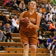 Kiowa County Lady Maverick Tierra West (#23) goes in for a layup during the Seventh Annual Keady Basketball Classic First Round game between the St. John Lady Tigers and the Kiowa County Lady Mavericks with St. John winning 47 to 31 at Larned Middle School in Larned, Kansas on December 9, 2014. (Photo: Joey Bahr, www.joeybahr.com)
