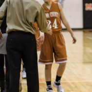 Members of the St. John Lady Tigers and Kiowa County Lady Mavericks shake hands following the Seventh Annual Keady Basketball Classic First Round game between the St. John Lady Tigers and the Kiowa County Lady Mavericks with St. John winning 47 to 31 at Larned Middle School in Larned, Kansas on December 9, 2014. (Photo: Joey Bahr, www.joeybahr.com)